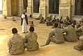 US Navy 030419-M-9124R-015 7th Marine Regiment Chaplin, Father Bill Devine speaks to U.S. Marines assigned to the 5th Marine Regiment during Catholic Mass at one of Saddam Hussein's palaces in Tikrit, Iraq.jpg