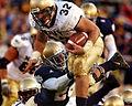 US Navy 031108-N-2899A-002 Navy fullback Kyle Eckel evades a Notre Dame defender.jpg