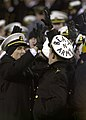 US Navy 031206-N-9693M-519 U.S. Naval Academy Midshipmen high-five each other to celebrate a Navy play during the 104th Army Navy game.jpg