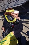 US Navy 040229-N-1464F-011 An excited spouse embraces her husband Aviation Electrician's Mate 3rd Class Steve Alvarez assigned to USS Enterprise (CVN 65) during the ship's homecoming.jpg
