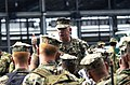 US Navy 040705-N-6811L-095 Gunnery Sgt. Carl Melrose of Headquarters and Service Company, 3rd Battalion, 3rd Marine Regiment provides crucial instructions before embarking aboard the amphibious assault ship USS Tarawa (LHA 1).jpg