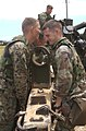 US Navy 040713-N-5055W-184 Members of the First Battalion, Twelfth Marine Regiment move a Howitzer 150 brace to gain a more accurate target site during an artillery live fire exercise.jpg