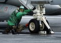 US Navy 050112-N-0057P-026 An Aviation Boatswain's Mate gives the signal to apply tension to one of four steam-powered catapults during flight operations aboard the Nimitz-class aircraft carrier USS Abraham Lincoln (CVN 72).jpg