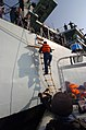 US Navy 050215-N-1444C-012 A Sailor assigned to the guided missile frigate USS Thach (FFG 43) boards the Royal Navy Type 23 frigate HMS Grafton (F80) for a multi-national exercise.jpg