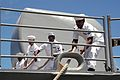 US Navy 050415-N-8937A-058 Sailors aboard the guided missile cruiser USS Vincennes (CG 49) heave the line as they prepare to moor in Pearl Harbor, Hawaii, for a scheduled port visit.jpg