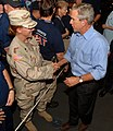 US Navy 050915-N-5345W-148 U.S. President George W. Bush meets with a crowd of Sailors, soldiers and relief organization personnel after returning to the amphibious assault ship USS Iwo Jima (LHD 7) following a live address to.jpg