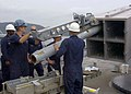 US Navy 051005-N-2970T-001 Fire Controlman 2nd Class Jared B.C. Lamson and Fire Controlman 3rd Class John D. Hermes upload a RIM-7 NATO Sea Sparrow missile into a launcher cell.jpg