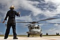 US Navy 060208-N-8134A-001 Airman Marchello Pangemanan gives the signal to start the second engine to the pilots operating an MH-60S Seahawk helicopter.jpg