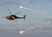US Navy 060511-N-0119G-001 An SH-60F Seahawk helicopter assigned to the Dragonslayers of Helicopter Antisubmarine Squadron Eleven (HS-11) releases flares