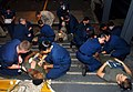US Navy 060823-N-4856C-032 Ship's Hospital Corpsman and stretcher-bearers report to a mass casualty drill in the well deck aboard the amphibious assault ship USS Iwo Jima (LHD 7).jpg