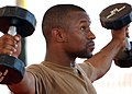 US Navy 060904-N-1328C-033 Equipment Operator 2nd Luis Martinez competes in Camp Lemonier Labor Day Strong Man Competition.jpg