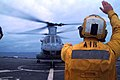US Navy 061122-N-4124C-030 Aviation Support Equipment Technician 3rd Class Sean Rapuhn, a landing signalman enlisted (LSE), prepares a CH-46 Sea Knight helicopter assigned to Medium Marine Helicopter Squadron One Six Five (HMM.jpg