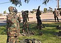US Navy 061123-N-3560G-012 Members of Naval Mobile Construction Battalion Four (NMCB-4) don chemical protective suits in a timed event during a Super Squad training competition.jpg