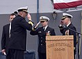 US Navy 061212-N-2716P-015 Cmdr. Robert P. Gonzales (right) and Cmdr. Paul J. Lyons (center) salute Commander Destroyer Squadron Fifteen Capt. Robert P. Girrier after reading their orders.jpg