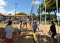 US Navy 070118-N-4965F-004 A Sailor jumps and stretches to return a volley during a volleyball tournament on board Naval Station Pearl Harbor during the annual Surface Navy Association, Surface Line Week.jpg