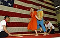 US Navy 070510-N-4207M-033 Master Chief Culinary Specialist Moises Lovinaria and Culinary Specialist 2nd Class Lyndsee Pereyra perform the Tinikling, a Filipino folk dance, during the Asian-American Pacific Islander Heritage ce.jpg