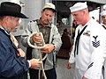 US Navy 070607-N-5324B-003 Boatswain's Mate 1st Class Larry Sherrill, aboard guided-missile frigate USS Vandegrift (FFG 48), watches a demonstration of the bowline knot from Leo Oates, a journeyman lineman for Clark Publi.jpg