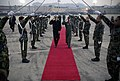 US Navy 071107-N-0696M-357 Brig. Gen. Punch Moulton, vice commander of 7th Air Force, escorts Chairman of the Joint Chiefs of Staff, Adm. Mike Mullen through a Osan Air Base honor guard, prior to departing Osan Air Base.jpg