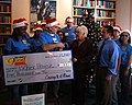 US Navy 071127-N-4163T-034 Local Wal-Mart store manager Casey O'Kane and fellow employees present Bell Esposito, manager of Naval Medical Center San Diego's (NMCSD) Fisher House, with a $5,000 donation from Wal-Mart Stores, Inc.jpg