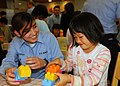 US Navy 081108-N-3215T-003 Cryptologic Technician (Collection) Seaman Zandria Curran plays with a girl at the Fukuoka Kodomo no Ie children's home.jpg