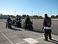 US Navy 081216-N-1825E-004 Volunteer motorcycle safety instructor Master-at-Arms 2nd Class Bradrick Hawkins instructs motorcycle riders to start their engines.jpg