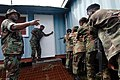US Navy 090105-N-0783S-001 Electricians Mate 2nd Class Byron Ross, left, assigned to Mobile Expeditionary Security Squadron 2, instructs members of the Jamaica Defense Force during a Southern Partnership Station boarding team m.jpg