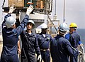 US Navy 090730-N-7280V-279 Sailors move ammunition on the main deck of the amphibious command ship USS Blue Ridge (LCC 19) while at anchorage in Tokyo Bay.jpg
