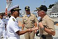 US Navy 090829-N-5013K-031 Cmdr. Takenaka Nobuyuki, left, commanding officer of the Japan Maritime Self-Defense Force submarine JS Narushio (SS 595), welcomes Capt. Murray Gero, commanding officer of the guided-missile submarin.jpg