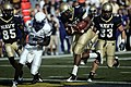 US Navy 091003-N-3404S-089 U.S. Naval Academy quarterback Ricky Dobbs (^4) crosses into the end zone to score a touchdown early in the first quarter.jpg