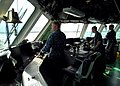 US Navy 100308-N-7058E-084 Chief Hospital Corpsman Joseph Dennis, Lt. Todd Sehl and Cmdr. Randy Garner watch from the bridge of USS Freedom (LCS 1) as the ship enters the port of Colon, Panama.jpg