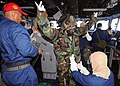 US Navy 100602-N-1082Z-022 Sailors don full protective gear during a simulated chemical, biological and radiological attack.jpg