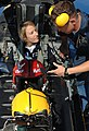 US Navy 110303-N-IR859-013 Crew Chief Aviation Structural Mechanic (Safety Equipment) 2nd Class Travis Simpson straps Capt. Kristin Hubbard into th.jpg