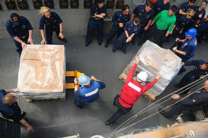 US Navy 120102-N-ZF681-313 Sailors aboard the guided-missile destroyer USS Halsey (DDG 97) move pallets of supplies during a replenishment at sea w.jpg