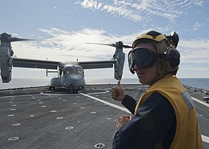 US Navy 120131-N-NR955-383 A Sailor gets instructions from the flight deck control tower.jpg
