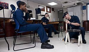 US Navy 120206-N-OY799-265 A Sailor displays how to apply a proper soft patch.jpg