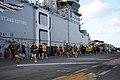 US Navy 120210-N-UE944-015 Sailors and Marines participate in a steel beach 5-kilometer-10-kilometer run on the flight deck of the amphibious assau.jpg