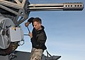 US Navy seaman prepares a CIWS for a live-fire exercise.jpg