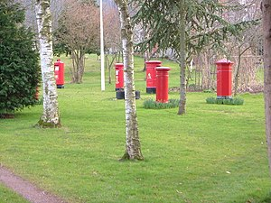 Collection of British Pillar boxes at the Inkpen Post Box Museum, near Taunton, Somerset