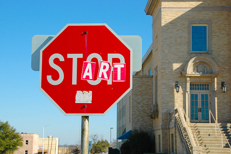 File:Vandalized stop sign - start and stop.jpg