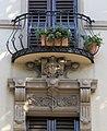 Viale mazzini 16, fi, palazzina con iscrizione 03 balcone con decorazione antropomorfa.JPG