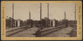 View of a railroad yard showing switches and tower, by Whitney, Beckwith & Paradice.png