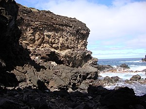 Volcanic rock cliff at Ana Kai Tangata, Easter...