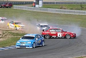 2005 World Touring Car Championship - Alain Menu (Chevrolet Lacetti) leads a spinning Fabrizio Giovanardi (Alfa Romeo 156) at Oschersleben on 28.08.2005