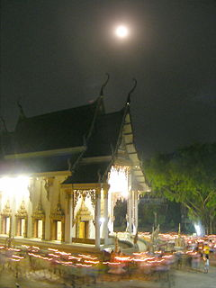 Walk with lighted candles in hand around a temple.jpg