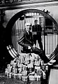 Warren G. Harding sits atop a night's poker winnings..jpg