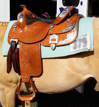 Saddle blanket - A western saddle placed over a saddle blanket.