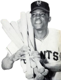 A smiling baseball player in a Giants uniform cradles six bats over his right shoulder