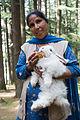 Woman feeding a rabbit in Manali in 2009.jpg