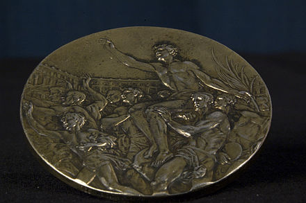 Reverse of John Woodruff's gold medal while on display at Hillman Library, University of Pittsburgh, Pittsburgh, PA. WoodRuff 1936 Olympics medal back.jpg