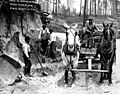 Workmen loading sand at a bend in the road for the Bothell road construction, Washington, May 14, 1912 (INDOCC 438).jpg